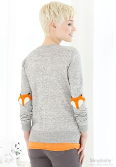 Create beautiful needle felted fox embellishments for the elbows of an old sweater! Great Inspiration for adding decorative accents to your clothing! #Simplicity #FreeProject #DIY