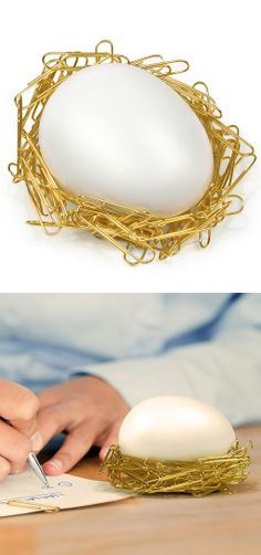 Desk egg // a magnetic egg that creates a nest out of stray paperclips - clever! #product_design