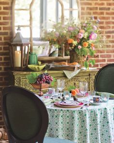 Dress up a porch table set for two with graceful green-and-white linens, artful china, and soft candlelight. #southernladymag #tablescapetuesday #tabletoptuesday #tabletop #tabletops #tablescape #styling #romanticdinner #southernporches #eleganceintheeveryday #summerinthesouth Porch Table, A Table, Cottage Dining Rooms, Southern Porches, Southern Ladies, Bright Flowers, Romantic Dinners, Dinner Menu, Tablescapes