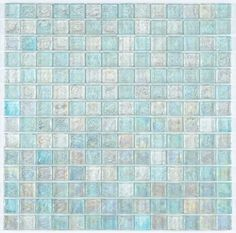 Iridescent Glass Mosaic Tile Clear Blend 1x1 is face mounted on a 12 inches by 12 inches clear tape sheet for an easy installation. Each individual tile chip is 8mm thick. Iridescent glass tiles refle