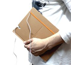 Smart Note 2. The new journal is made to hold the iPhone 4 within, acting as a carrying case for the device at the same time. the cut-outs on each page continue throughout the notebook, allowing the user to interact with the digital nature of their iPhone, in relation to the physicality of paper simultaneously.