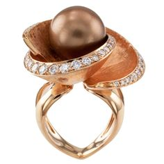 Beautiful ROSE Gold and Chocolate Pearl !     ( FOLLOW OUR BOARDS !) Chocolate Color Tahitian Cultured Pearl Diamond Rose Gold Ring | From a unique collection of vintage cocktail rings at https://www.1stdibs.com/jewelry/rings/cocktail-rings/