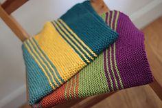Ravelry: Simply Stripes Baby/Lap Blanket pattern by Elizabeth Smith. May try an afghan crochet stitch, single or half double crochet to get same look...