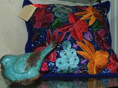 a pillow made from Guatemalan textile