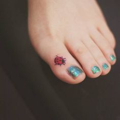 Small ladybug tattoo on the toe. Tattoo artist: Seoeon