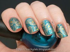 Nicole by OPI Deck the Dolls and stamped it with Essence A Piece of Forever using a paisley pattern (and it's mirror image) from Cheeky jumb...