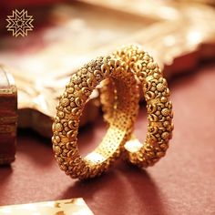 Bangle Designs every Bride-to-be will Instantly fall in love with! Gold Bangles Design, Gold Jewellery Design, Bridal Bangles, Bridal Jewelry, Silver Jewellery Indian, Silver Jewelry, Temple Jewellery, Silver Ring, Manubhai Jewellers