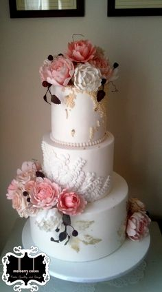 Vintage Pink Peony  Vintage Pink Peony 3 tier white vintage wedding cake with pink peonies and roses, gold painted leaves and embossed petals.