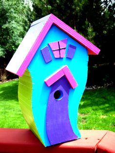 Whimsical bird house for your back yard, front yard or patio.  Great gift.  Found it at NanySaporta on Etsy.