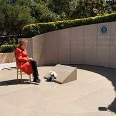 Former First Lady, Nancy Reagan sitting at husband Ronald Reagan's final resting…