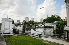 Many cemeteries in New Orleans feature the famous above-ground tombs, which are lined up along long paths or avenues across the cemetery grounds. Dark Places, Places To Go, St Louis Cemetery, New Orleans Cemeteries, Interview With The Vampire, New Orleans French Quarter, Paths, Things To Do, Around The Worlds