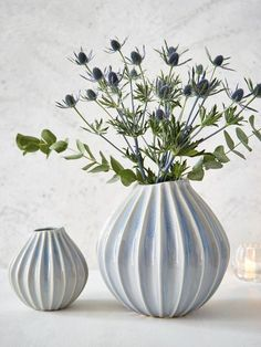 With strong graphic lines and graceful curves, these gorgeous pale blue vessels will create winning displays of delicious  flowers and fronds of greenery.