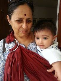 "Bhawna owns a Rosewood Red Soul Sling and was the first one to pre-order her next Soul Sling!  This is what she says - ""Can't imagine a life without Soul sling right now and I desperately need to pick up more.""  Here's a photo of her son with her mother in our sling!"