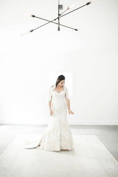 """Kristina looks like a piece of fine art - from the perfect shape of her """"Emma"""" wedding gown to the dreamy surroundings.  Wedding dress by Matthew Christopher . #marriedinmatthew Photo: Lori Baskin Photography"""