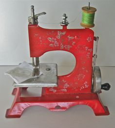 This exquisite tin toy sewing machine decorated with flowers was one of my challenges. I restored and timed. It sew perfect ! SOLD !