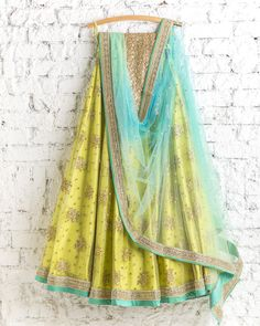 Lehengas by SwatiManish : Lemon yellow lehenga and sky blue dupatta