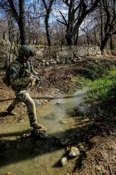 Over the creek… A U.S. Special Forces Soldier with the Combined Joint Special Operations Task Force- Afghanistan, crosses a small creek during a clearance operation in Gaza Valley, Arghandab district, Zabul province, Afghanistan,  on Dec. 11, 2013.