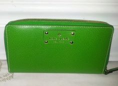 """UP FOR SALE ISA LIGHTLY USED100% AUTHENTICKate Spade Wellesley Neda Leather Wallet Clutch Budgreen ZIP AROUND WLRU1153    Real and authentic.    This Beautiful wallet is Used with very Minor signs of previous Use, and lots of life left in it.    Its Clean with NO UNUSUAL SMELLS OR ODORS, and No Stains.                 Measurements:    length: 7.5""""    Width : 4.5""""    Thickness: 1""""    Please See attached Photos as part of description.    From a smoke Free pet free home.    Don't…"""