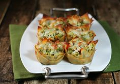 These Chicken Pesto Wonton Cups are a perfectly portioned and delicious muffin tin meal! Only 170 calories or 4 Weight Watchers points each! www.emilybites.com
