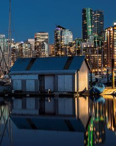 Blurred Lines  . Coal Harbour blue hour reflections. Captured from Stanley Park in Vancouver British Columbia Canada  May 6 2017