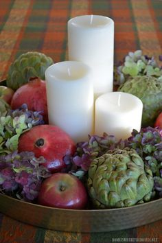 Tray centerpiece with candles, pomegranates, artichokes, hydrangeas and apples | homeiswheretheboatis.net