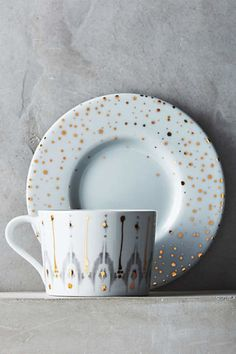 Ikat Thistle Cup & Saucer. Anthropologie. Gold accents and cool gray ikat markings form a neutral, yet gleaming backdrop for mealtime or teatime.