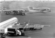 Chicago Midway Airport - Northwest Airlines - Boeing 377 (Stratocruiser) (1956) (N74609) Smoky Connie almost obscuring an Eastern Martin 404.