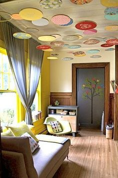 love the embroidery hoops on ceiling! would be great in a kids room! could use fabric or scrapbook paper