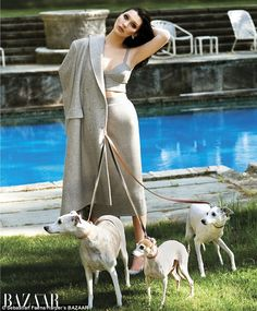 Canine companions: Despite only being 18, the 5ft9in model did her best to channel Whitney...
