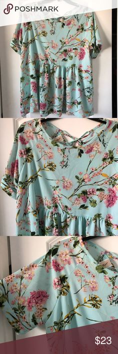 Floral peplum flowy top shirt blouse lace up tie Floral peplum blouse with lace up tie on back. Pretty detailed floral. Light blue, pink, green. Very cute paired with skinny jeans and sandals or booties. Can also be worn with a pencil skirt or a cardigan overtop. Great closet staple! Size can fit medium or large. Brand new, perfect condition. Never worn, tags have been detached. Tops