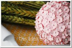 scrapbook flowers + white straight pins + Styrofoam ball. would look cute on top of a candlestick and part of a centerpiece
