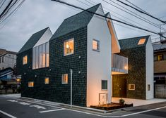 This Tokyo house and office for a funeral director has been split into three sections so that two can be removed later, in case a planned road gets built through the site.