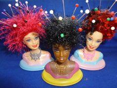 La testa di Barbie come puntaspilli