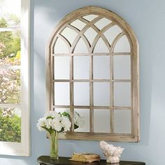 From Kirklands Our Distressed Cream Sadie Arch Mirror is reminiscent of an arched cathedral. This decorative mirror is romantic and rustic and perfect for an entryway or living room. Arched Window Mirror, Arch Mirror, Arched Windows, Wall Mirrors, Mirror Ideas, Faux Window, Mirror Art, Window Frames, Cathedral Mirror