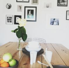 Clean, white dining room, with plenty of character and love {via erin loechner}