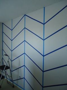 way easy way to do chevron without tons of measuring and line marking! gonna tweak it and cut the pieces out of the stripes that are going up and down so have solid stripe across the wall