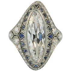 1920s Art Deco Sapphire Diamond Platinum Cocktail Ring. A superb Art Deco Diamond, Sapphire and Platinum ring, featuring a fabulous 3ct (approx) antique oval/marquise cut diamond. G+ in color and VVS2+ in clarity. c 1920