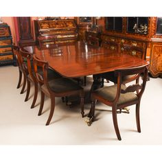 An elegant dining set comprising an antique Regency dining table and a set of bespoke dining chairs in the Regency manner. Buy Dining Table, Vintage Dining Chairs, Table 19, Table And Chair Sets, Dining Set, Mahogany Furniture, Antique Furniture, Elegant Dining, Furniture Collection
