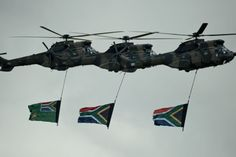 Military helicopters carrying south african flags fly over Nelson Mandela burial site in Qunu on December 15, 2013 during his funeral.
