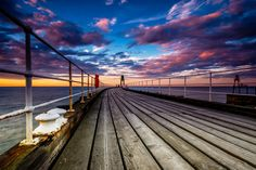 Whitby Pier Sunset  The sun lights the sky as is sets over the North Yorkshire town of Whitby