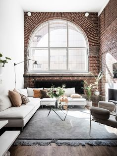 living room | interior design | exposed brick wall | big grid window | white sofa | modern | simple | neutral