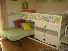 customise ikea kura, stick a toddler bed underneath, and have trofast shelves as steps up the side.