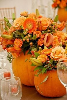 Gorgeous Fall Flowers in Pumpkin Vases.