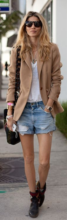 Chic in a camel jacket, white tee, denim shorts and cowboy boots