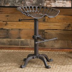 """Adjustable Industrial Tractor Seat Stool-  Heavy iron finished in a rust finish, rustic/industrial chic. The detailed legs are reminscent of the Victorian era, while the seat is a replica of a tractor seat. Meant for counter height use only. Stool weighs 24 lbs. Seat spins to adjust height. (24""""-32""""Hx18""""Wx14""""D 24 lbs);Product SKU: XU1111 RU Price:  $169.00"""