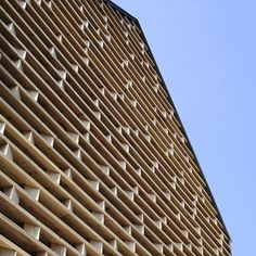 love this screen using repetitive horizontal wood mixed with random verticals
