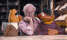 Mr Hooper in a serious discussion with Ernie and Burt!