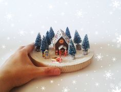 Gingerbread house in the woods. Polymer clay winter home decoration
