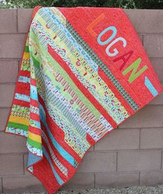 jelly roll quilts | Appliqued Jelly Roll Race Quilt
