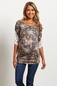 This bump flattering shirt will go with any look. Wear it with jeans and a cardigan to get a cute, casual look. The crochet accent on the sleeves will be sure to give that extra feminine touch.